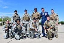 U.S Air Force Col. Mike Drowley, 355th Wing commander, poses for a photo with 355th Security Forces defenders at Davis-Monthan Air Force Base, Ariz., April 11, 2019.