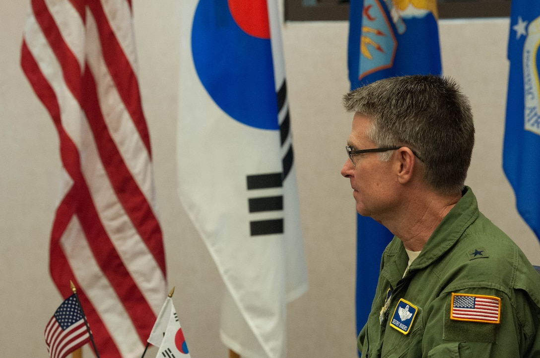 United States Air Force Brig. Gen. Harold E. Rogers, Mobilization Assistant to the Director, Air and Cyberspace Operations, Headquarters Pacific Air Forces, talks with Republic of Korea Brig. Gen. Dae Joon Park, ROKAF Academy commandant, during the ROKAFA's visit to Joint Base Pearl Harbor-Hickam, Hawaii, Apr. 2, 2019.