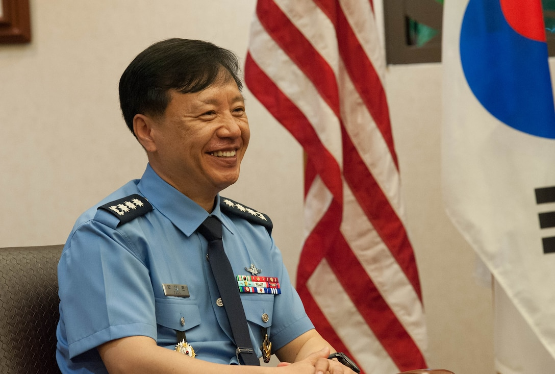 Republic of Korea Brig. Gen. Dae Joon Park, ROKAF Academy commandant, talks with United States Air Force Brig. Gen. Harold E. Rogers, Mobilization Assistant to the Director, Air and Cyberspace Operations, Headquarters Pacific Air Forces, during the ROKAFA's visit to Joint Base Pearl Harbor-Hickam, Hawaii, Apr. 2, 2019.