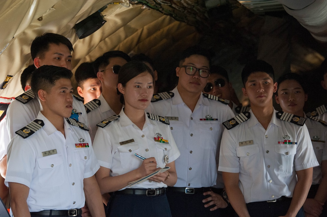 Republic of Korea Air Force academy cadets learn about the United States Hawaii Air National Guard's KC-135 Stratotanker during a visit to Joint Base Pearl Harbor-Hickam, Hawaii, Apr. 2, 2019.