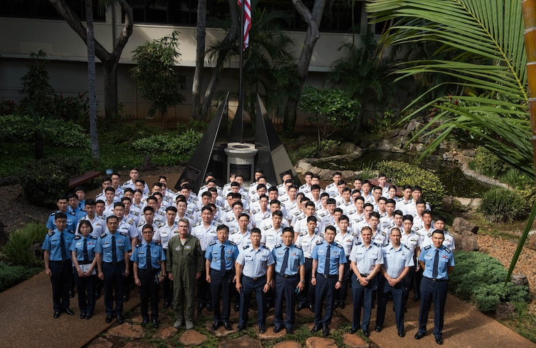 A group of Republic of Korea Air Force Academy cadets take a group photo with United States Air Force personnel in the Courtyard of Heroes during a visit to Headquarters Pacific Air Forces, Joint Base Pearl Harbor-Hickam, Hawaii, Apr. 2, 2019.