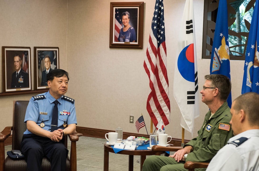 Republic of Korea Brig. Gen. Dae Joon Park, ROKAF Academy commandant, and United States Air Force Brig. Gen. Harold E. Rogers, Mobilization Assistant to the Director, Air and Cyberspace Operations, Headquarters Pacific Air Forces, meet during a visit to Joint Base Pearl Harbor-Hickam, Hawaii, Apr. 2, 2019.