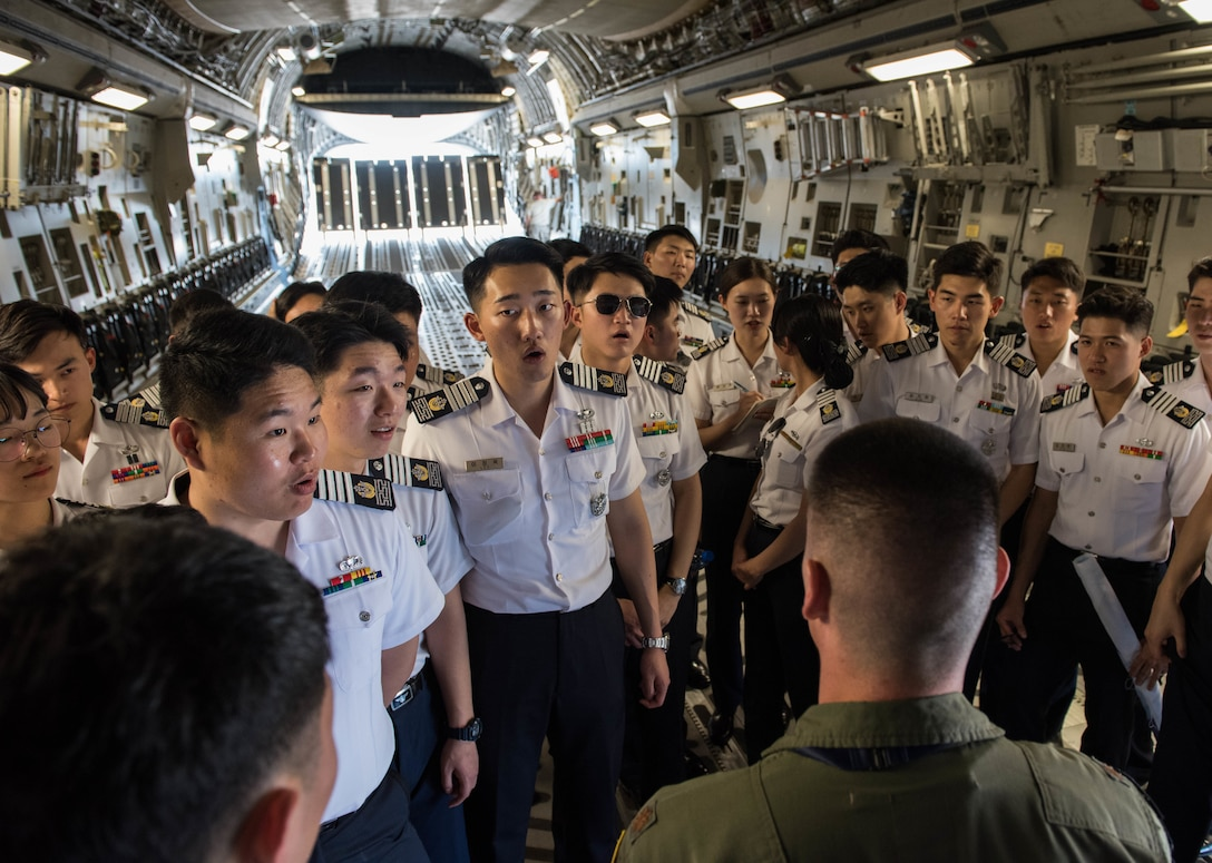 A group of Republic of Korea Air Force academy cadets learn more about a United States Hawaii Air National Guard C-17 Globemaster III during a visit to Joint Base Pearl Harbor-Hickam, Hawaii, Apr. 2, 2019.