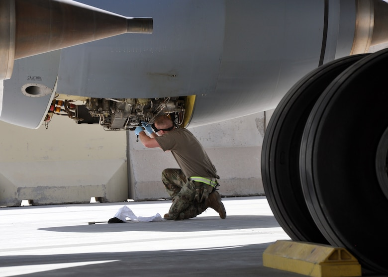 An Airman from the 451st Expeditionary Aircraft Maintenance Squadron performs maintenance on a KC-135