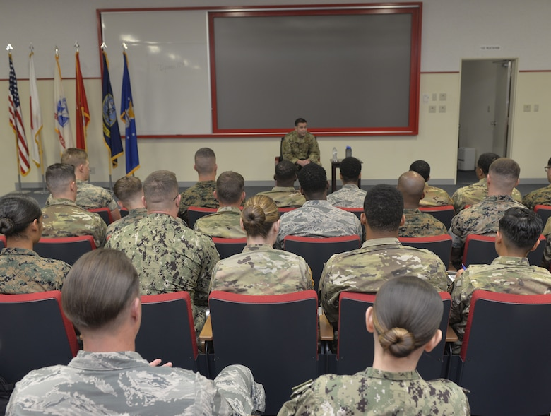 U.S. Air Force Command Chief Master Sgt. Rick Winegardner, U.S. Forces Japan Command Senior Enlisted Leader, discusses the future of warfighting across the Pacific theater of operations and how it will include U.S. servicemembers from all branches with members of the Okinawa Joint Experience April 1, 2019, at Kadena Air Base, Japan. With the military becoming more and more integrated in order to ensure mission success, leaders at every level must know and be comfortable operating in a joint environment. (U.S. Air Force photo by Staff Sgt. Benjamin Sutton)