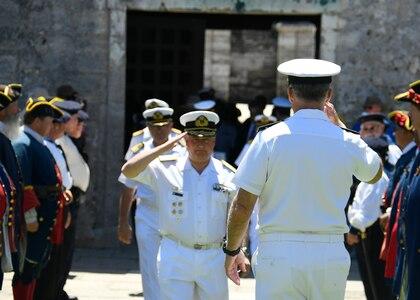 Commander, U.S. 4th Fleet, Rear Adm. Sean Buck salutes Argentine Commander, Navy Training and Readiness Command, Rear Adm. Fabian Gerardo D'Angelo.