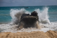 A U.S. Marine Corps amphibious assault vehicle assigned to Combat Assault Company, 3d Marine Regiment, crashes into the tides during an amphibious assault exercise at Marine Corps Training Area Bellows, Marine Corps Base Hawaii, Apr. 9, 2019. The unit conducted a simulated beach assault to improve their lethality and cooperation, as a mechanized unit and force in readiness.