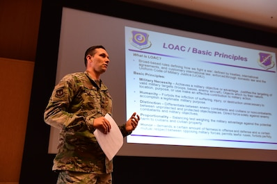 Capt. Ryan Ewin, 39th Air Base Wing deputy staff judge advocate, gives a brief on the Laws of Armed Conflict during ancillary training Feb. 13, 2019, at Incirlik Air Base, Turkey. The ancillary training consolidated six computer based trainings into one briefing, which met an Air Force initiative to ensure Airmen's time is used in the most effective manner. (U.S. Air Force photo by Senior Airman Trevor Gordnier)