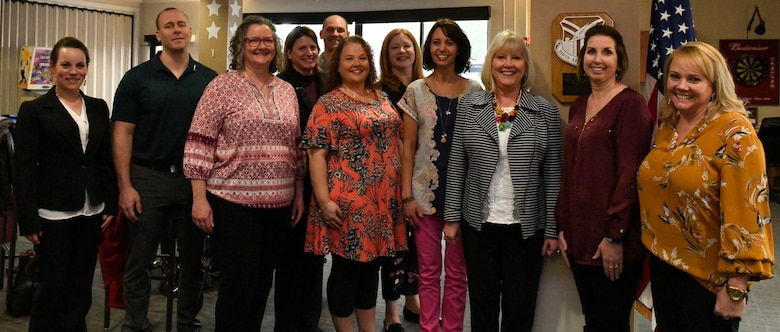 Suzie Schwartz (3rd from right), wife of the 19th Chief of Staff of the Air Force Gen. (retired) Norton Schwartz, poses with the YARS Key Spouse group at the Kubli Morale and Wellness Center here, April 6, 2019.