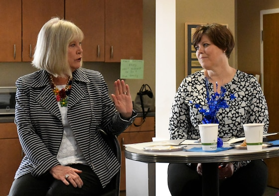 Terri Ann Naughton, director of psychological health for the 910th Airlift Wing, discusses the role of her position with Suzie Schwartz at the Kubli Morale and Wellness Center here, April 6, 2019.