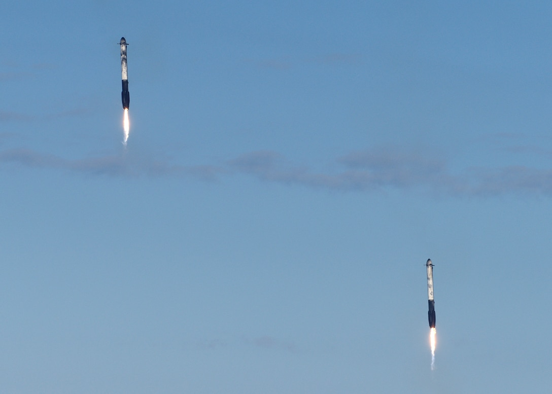 Two boosters sit atop a landing zone after the successful launch and landing of SpaceX's Falcon Heavy Arabsat 6A on April 12, 2019 at Kennedy Space Center, Fla. This marks the second launch of the Falcon Heavy rocket; the most powerful space vehicle flying today. (U.S. Air Force photo by Airman 1st Class Zoe Thacker)