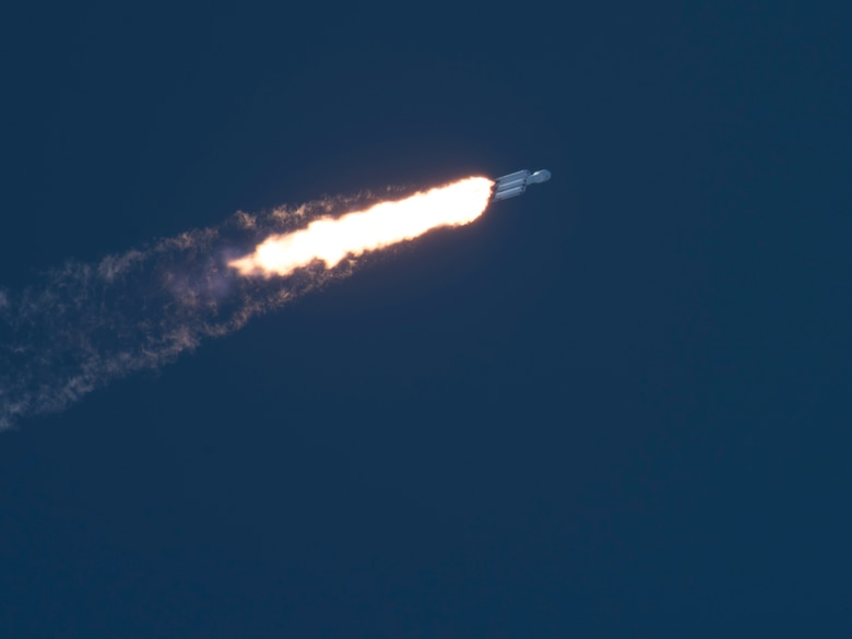 SpaceX's Falcon Heavy Arabsat 6A rocket leaves the Earth's atmosphere after launching from Space Launch Complex 39A on April 12, 2019 at Kennedy Space Center, Fla. This marks the second launch of the Falcon Heavy rocket; the most powerful space vehicle flying today. (U.S. Air Force photo by 2nd Lieutenant Alex Preisser)