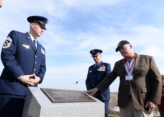 U.S. Air Force Chief Master Sgt. Brian Thomas, 55th Wing command chief, left, U.S. Air Force Col. Michael Manion, 55th Wing commander, and Joe Spivey, 55th Wing Association president and retired Air Force colonel, unveil the new monument dedicated to all of the past, present and future members of the 55th Wing during a ceremony at the Omaha National Cemetery in Omaha on April 6, 2019. This is the second monument the association has dedicated to the 55th Wing with the first being located at the Air Force Museum at Wright-Patterson Air Force Base, Ohio. (U.S. Air Force photo by Charles Haymond)