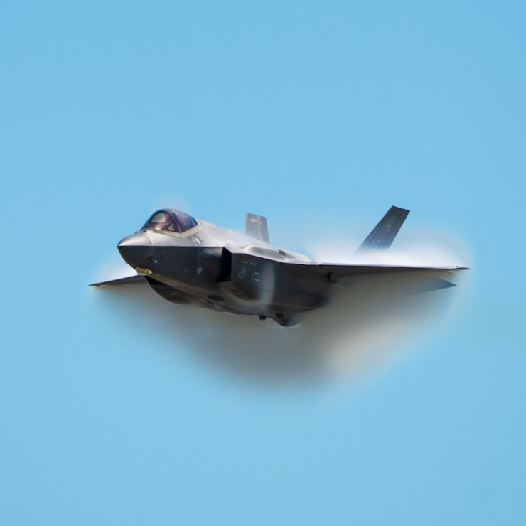 "Capt. Andrew ""Dojo"" Olson, F-35 Demonstration Team pilot and commander performs a high-speed pass during the Melbourne Air and Space Show March 29, 2019 in Melbourne, Fla. The air show featured the North American Debut of the all-new F-35 Demonstration. (U.S. Air Force Photo by Senior Airman Alexander Cook)"