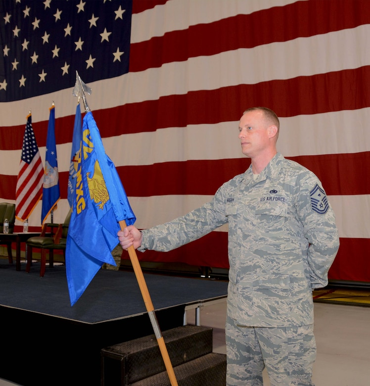 Senior Master Sgt. Christopher Brigan, 507th Maintenance Group first sergeant, wields the guidon during the 507th Maintenance Group assumption of command ceremony at Tinker Air Force Base, Oklahoma, April 7, 2019. (U.S. Air Force photo by Tech. Sgt. Samantha Mathison)