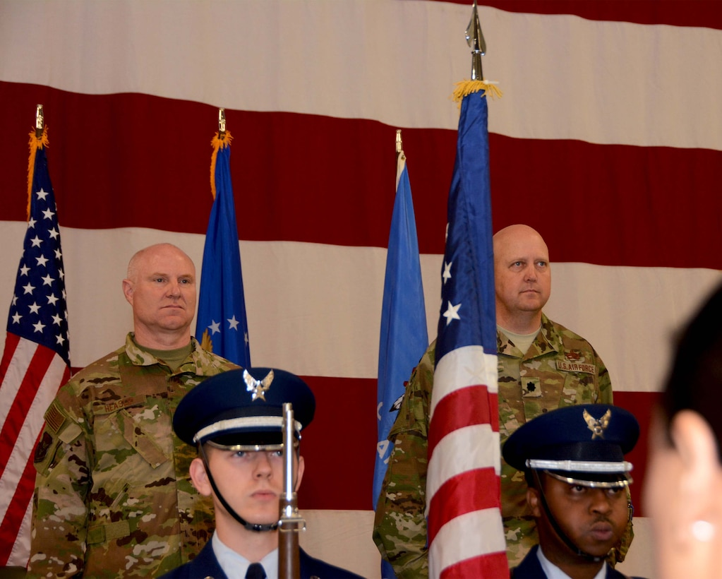 507th Air Refueling Wing commander, Col. Miles Heaslip, and Lt. Col. Karwin Weaver, stand at attention for the presentation of the colors during the 507th Maintenance Group assumption of command ceremony at Tinker Air Force Base, Oklahoma, April 7, 2019. (U.S. Air Force photo by Tech. Sgt. Samantha Mathison)