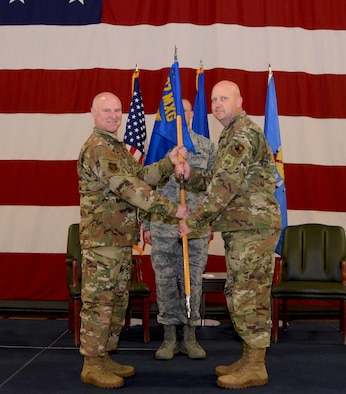 507th Air Refueling Wing commander, Col. Miles Heaslip, hands the command guidon to Lt. Col. Karwin Weaver, during the 507th Maintenance Group assumption of command ceremony at Tinker Air Force Base, Oklahoma, April 7, 2019. (U.S. Air Force photo by Tech. Sgt. Samantha Mathison)