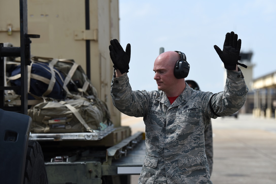 U.S. Air Force Tech. Sgt. Brian Teachout, 81st Logistics Readiness Squadron Small Air Terminal NCO in charge, directs a forklift operator to unload cargo in support of exercise Neptune Guardian on Keesler Air Force Base, Mississippi, April 5, 2019. The 81st LRS acted as a one-stop shop for ground and air transportation as well as munition requirements for joint exercise Neptune Guardian between the U.S. Coast Guard and U.S. Navy. (U.S. Air Force photo by Senior Airman Suzie Plotnikov)