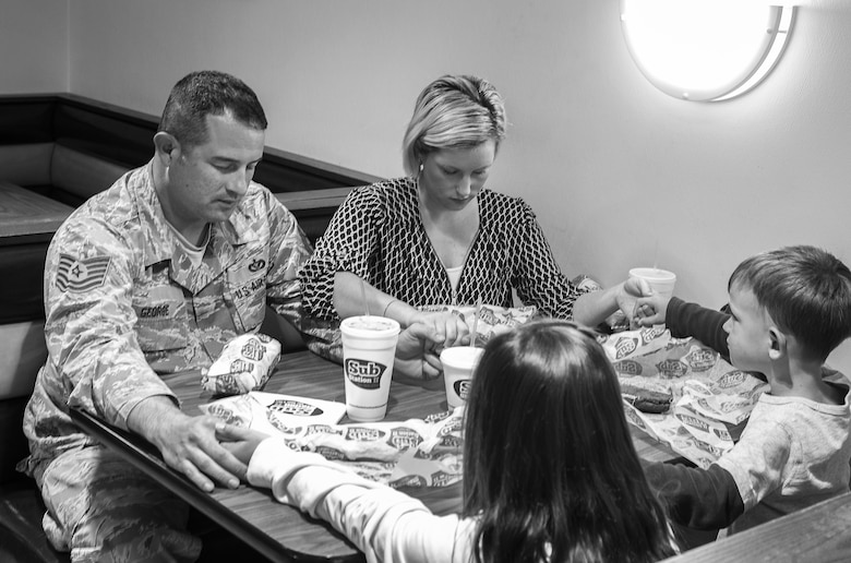 U.S. Air Force Tech. Sgt. Craig George, 20th Civil Engineer Squadron B-shift assistant chief of operations, says grace before having dinner with his family at Shaw Air Force Base, S.C., April 9, 2019.