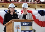 PASCAGOULA, Mississippi -- Shana McCool (left) and Kate Oja, ship sponsors of the future USS Richard M. McCool Jr. (LPD 29), speak about their grandfather during the keel authentication ceremony for the ship at Huntington Ingalls Industries Pascagoula shipyard April 12. Then a Navy captain, McCool received the Medal of Honor for his heroic actions in rescuing survivors from a sinking destroyer and for saving his own landing support ship during an enemy attack while injured.
