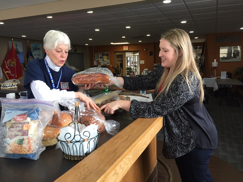 Volunteer Tosca Hallock (left) and USO Center Manager Whitney Armstrong sort free bread for visitors inside Bldg. 1222, Kittyhawk Center, Area A, Wright-Patterson Air Force Base. (Skywrighter photo/Amy Rollins)