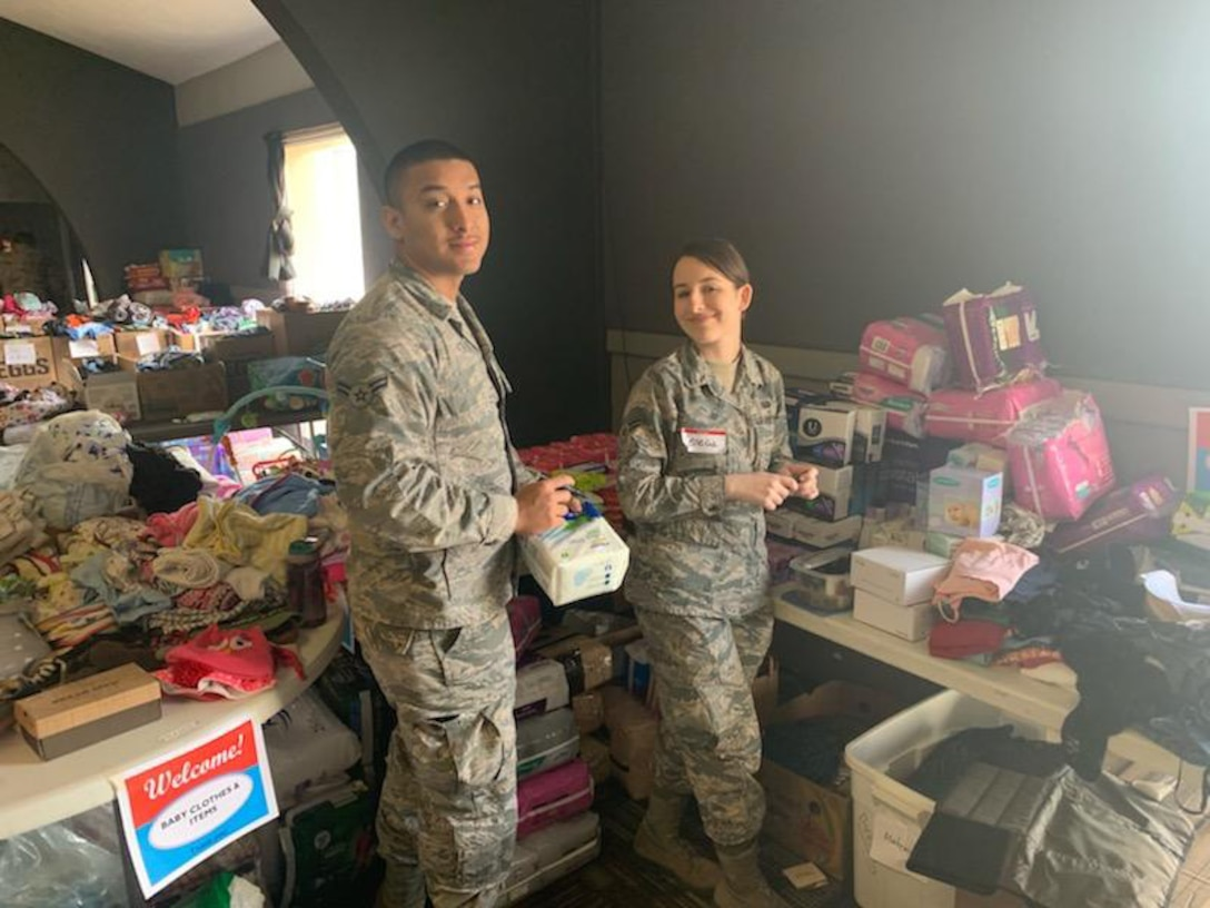 U.S. Air Force Airmen with the 20th Intelligence Squadron, 363rd Intelligence, Surveillance and Reconnaissance Wing, sort and distribute clothes, cleaning supplies, toys and food at the Bellevue Christian Center in Nebraska, March 18-21, 2019. Airmen, civilian and industry partners from the 20th IS volunteered to provide assistance and relief efforts to those affected by recent flooding in Nebraska and Iowa. (Courtesy photo)