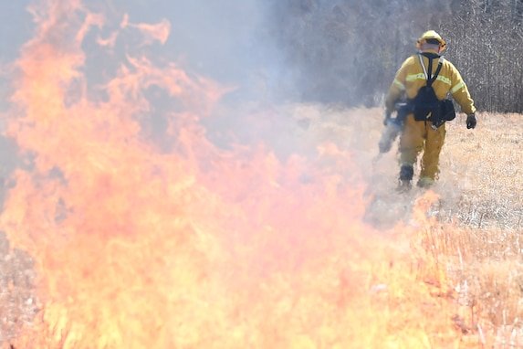 .Firefighters conduct, contain controlled burns