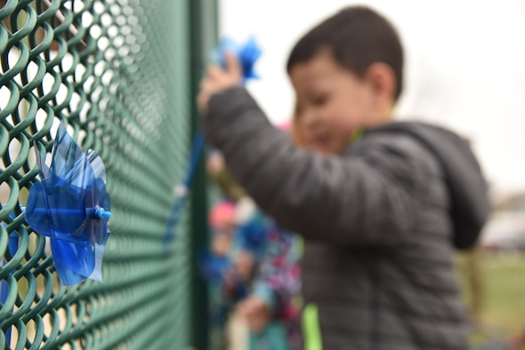 Children at the base child development center place pinwheels on a fence during Child Abuse Prevention Month April 11, 2019, at Malmstrom Air Force Base, Mont.