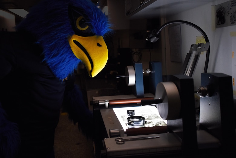 Wally the Warhawk, 548th Operations Support Squadron mascot, tours the Film Processing Center during the 548th Intelligence, Surveillance and Reconnaissance Group open house at Beale Air Force Base, California, April 3, 2019. Tours, briefings and demonstrations during the event gave attendees an inside look at the important work their Airmen do. (U.S. Air Force photo by Airman 1st Class Jaylen Molden)