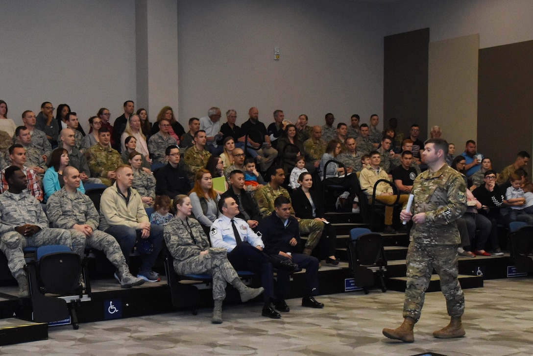 U.S. Air Force Col. Scott Nahrgang, 548th Intelligence, Surveillance and Reconnaissance Group commander, briefs attendees on the importance of the work their Airmen do during the 548th ISRG open house at Beale Air Force Base, California, April 3, 2019. While family members were touring exhibits, they were also able to enjoy food and spend time getting to meet their Airman's wingmen. (U.S. Air Force photo by Airman 1st Class Jaylen Molden)