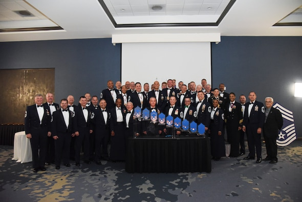 Recently inducted Chief Master Sergeants pose in front of current Chief Master Sergeants at the recognition ceremony in Melbourne, Fla., April 5, 2019. Eight Chief's from the 920th Rescue Wing were recognized during the ceremony, 11 total from Patrick Air Force Base, Florida, becoming one percent of the Air Force. (U.S. Air Force photo by Senior Airman Cali Elliott)