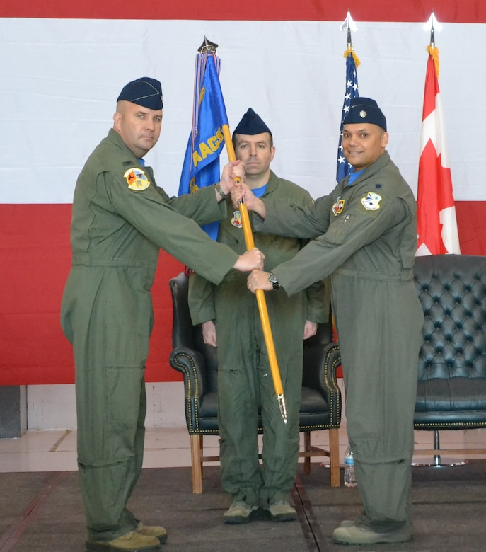 Lt. Col. Marty Slovinsky accepts command of the 966th Airborne Air Control Squadron in an official ceremony on April 12.  The change of command was presided over by Col. Stephen Carocci, commander of the 552nd Training Group while Senior Master Sgt. Richard Babcock, senior enlisted manager of the 966th AACS, served as the guidon bearer. (U.S. Air Force photo/2nd Lt. Ashlyn K. Paulson).