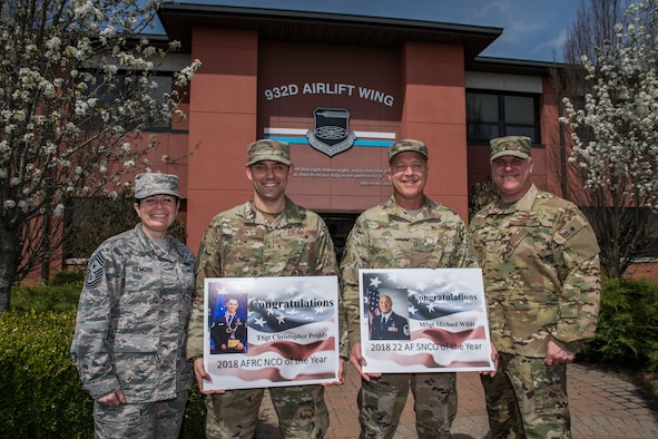 From left to right, 932nd Airlift Wing Command Chief Master Sgt. Barbara Gilmore, Tech. Sgt. Christopher Priddy, Master Sgt. Michael Wildt and acting 932nd AW Commander, Col. Michael Cruff take a moment during the April unit training assembly (UTA) to take photo highlighting the personal accomplishments of Priddy and Wildt.  Priddy is the 2018 Air Force Reserve Command Noncommissioned Officer in Charge of the Year and Wildt is the 2018 22nd Air Force Senior Noncommissioned Officer in Charge of the Year. (U.S. Air Force photo by Master Sgt. Christopher Parr)