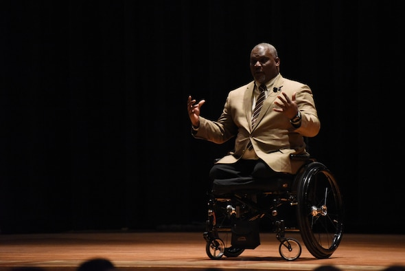 Retired Army Col. Gregory Gadson speaks to Airmen during a special presentation April 11, 2019, at the theater on Malmstrom Air Force Base, Mont.