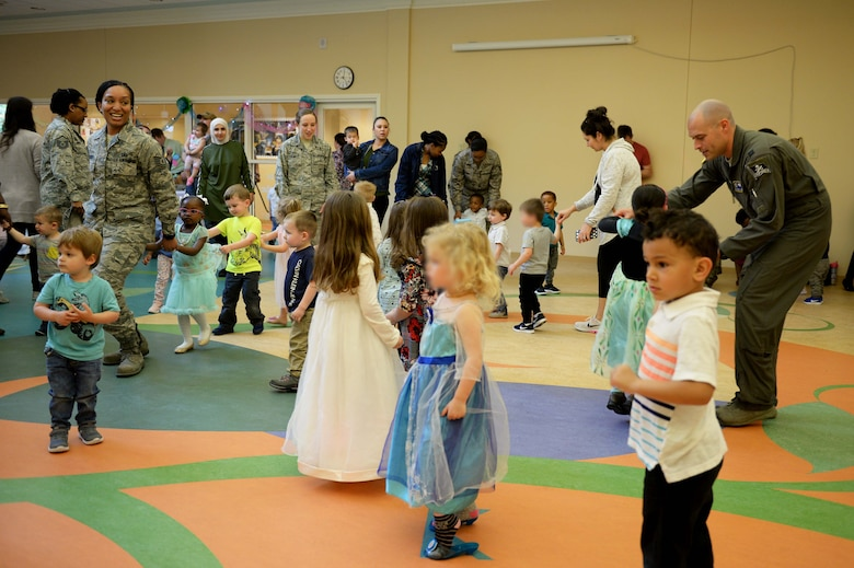 Parents dance with their Children the Child Development Center Ball dress up and dance, April 5, 2019, on Columbus Air Force Base, Miss. Sponsored by the Department of Defense Military Community and Family Policy, the Pentagon, military branches and other agencies use the month to recognize military kids for their bravery on the home front. (U.S. Air Force photo by Airman Hannah Bean)