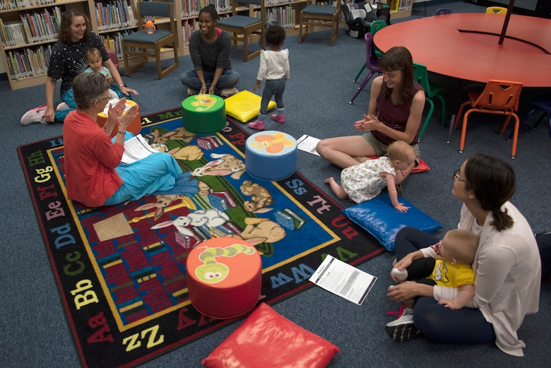 Kathryn Puckett, 56th Force Support Squadron senior library technician, sings with children and their parents during Babytime April 2, 2019, at Luke Air Force Base, Ariz.