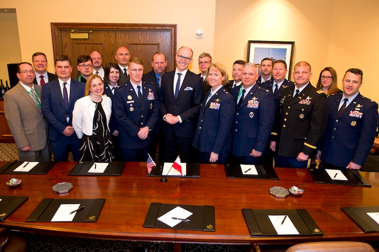 U.S. Space representatives within the Department of Defense pose for a group photo with Michal Szaniawski, acting president of the Polish Space Agency, following the signing of an agreement for space situational awareness (SSA) services and data at the 35th Space Symposium in Colorado Springs, Colo., April 10, 2019. Szaniawski signed the agreement as part of a larger effort to support spaceflight planning and enhance the safety, stability and sustainability of space operations. Poland joins 18 nations, two intergovernmental organizations, and 77 commercial satellite owners, operators, launchers already participating in SSA data-sharing agreements with USSTRATCOM.