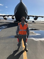 Staff Sgt. Nicholas Brown, 15th Wing Public Affairs specialist, prepares to marshal a C-17 at Hickam Field, Joint Base Pearl Harbor-Hickam, Feb. 26, 2019. SSgt Brown shadowed Tech. Sgt. Darrell Walton, 15th Aircraft Maintenance Squadron crew chief, for the day. (U.S. Air Force photo by Tech. Sgt. Darrell Walton)