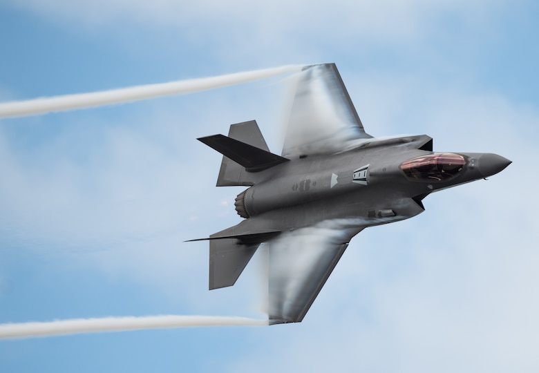 """U.S. Air Force Capt. Andrew """"Dojo"""" Olson, F-35 Demonstration Team pilot and commander, performs a dedication pass during the Melbourne Air and Space Show in Melbourne, Fla., March 30, 2019. During the two-day event, more than 50,000 guests attended the Melbourne Air and Space Show. (U.S. Air Force photo by Senior Airman Alexander Cook)"""