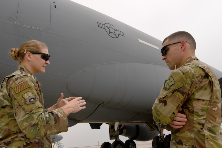 U.S. Air Force 1st Lt. M. Rebecca Kretzer, 380th Expeditionary Maintenance Group Depot Liaison Engineer, discusses common maintenance requests during turnover with her replacement, Maj. Joseph Czabaranek, April 11, 2019.
