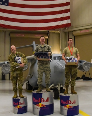 Capt. Alex Arntz, standard and evaluation program manager with the 315th Operational Support Squadron here, at left, Cadet Oliver Smith with Air Force ROTC at Clemson University, middle, and Senior Airman Justin Lacefield, aerospace propulsion specialist with the 437th Aircraft Maintenance Squadron, right, earned the top three awards in the Paper Wings airtime competition sponsored by Red Bull April 13, 2019 at Joint Base Charleston, S.C.  The winner, Smith, built a plane that had a hang time of 5.69 seconds. (U.S. Air Force photo by Airman 1st Class William Brugge)