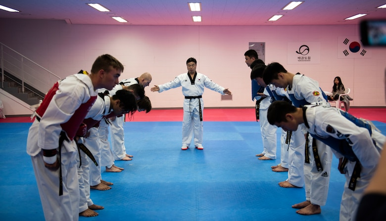 Members from the United States Forces-Korea and Republic of Korea Army soldiers bow before a sparring match during a Korean Ministry of Defense tour at Muju, Republic of Korea, April 9, 2019. The MND Taekwondo camp gave U.S. service members a chance to practice Taekwondo and learn about its history and importance to Korean culture. (U.S. Air Force photo by Senior Airman Stefan Alvarez)