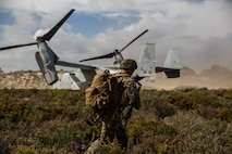 A U.S. Marine with Special Purpose Marine Air-Ground Task Force-Crisis Response-Africa 19.2, Marine Forces Europe and Africa, extracts from the landing zone on an MV-22B Osprey during a Tactical Recovery of Aircraft and Personnel exercise in Troia, Portugal, April 5, 2019