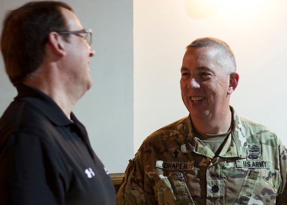 Chaplain (Lt. Col.) Bill Draper of the Kentucky Joint Force Headquarters shares a quick laugh with Keith Wichmann of the John Hopkins Applied Physics Laboratory after a lecture at Cyber Shield 19 held at Camp Atterbury, Ind., April 8, 2019.  Draper was enlisted in the Army for 18 years before starting his career as a chaplain in 2004; he has 37 years of service.