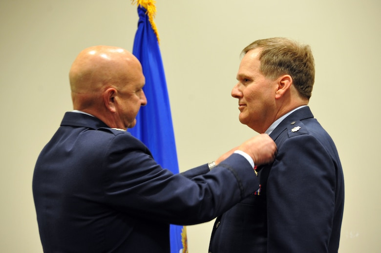 Col. Jay Johnson, 403rd Maintenance Group commander, presents Chaplain Lt. Col. R. Patrick Thompson, Wing Chaplain for the 403rd Wing, his Meritorious Service Medal at his retirement ceremony during the April Unit Training Assembly at the Roberts Maintenance Facility, Keesler Air Force Base, Miss. Chaplain Thompson's official retirement date is July 2, 2019 on his birthday. (U.S. Air Force photo by Master Sgt. Jessica L. Kendziorek)