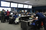 The Coast Guard and members of multiple partner agencies participate in Integrated Advance 2019 exercise at the Miami-Dade County Emergency Operations Center, April 12, 2019. Integrated Advance provides an opportunity for the Coast Guard, SOUTHCOM and its component commands, and multiple partners from varying levels in the Federal, State, and local governments, to exercise the whole of government response to a maritime mass migration scenario in the Caribbean.Coast Guard Photo by Petty Officer 3rd Class Brandon Murray.