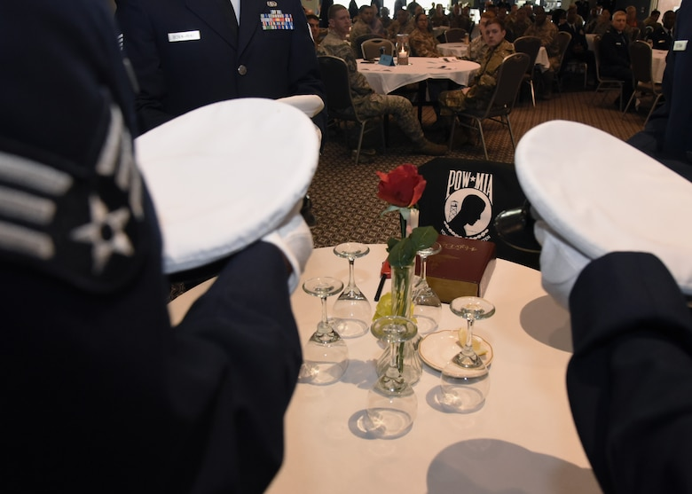 U.S. Air Force Airman Leadership School graduates set the POW/MIA with service hats from each of the branches during the ALS Graduation Ceremony in the Event Center at Goodfellow Air Force Base, Texas, April 11, 2019. The POW/MIA Table holds a place of honor during special events in memory of military members that are missing, have fallen or captured by enemies. (U.S. Air Force Photo by Airman 1st Class Abbey Rieves/Released)