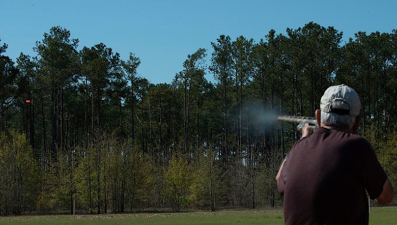 Rodney Raines, Amateur Trapshooting Association (ATA) member, shoots at an orange clay target at the 20th Force Support Squadron Trap and Skeet Range at Shaw Air Force Base, S.C., April 4, 2019.