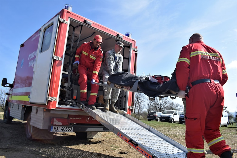 Maj. Robert Wetzler, pediatrician, 86th Medical Group, Ramstein Air Base, Germany, participates in a multinational medical exercise drill during Vigorous Warrior 19, Cincu Military Base, Romania, April 9, 2019. Vigorous Warrior 19 is NATO's largest-ever military medical exercise, uniting more than 2,500 participants from 39 countries to exercise experimental doctrinal concepts and test their medical assets together in a dynamic, multinational environment. (U.S. Air Force photo by 1st Lt. Andrew Layton)