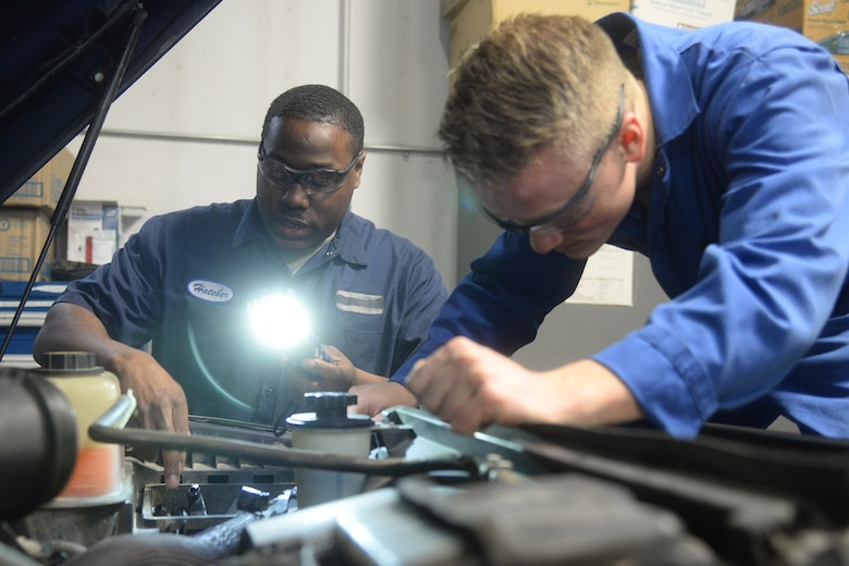 Staff Sgt. Willie Hatcher, 341st Logistics Readiness Squadron firetruck and refueler maintenance apprentice, left, and Airman 1st Class Joshua Byers, 341st LRS vehicle mechanic, examine the engine bay of a fleet vehicle April 9, 2019, at Malmstrom Air Force Base, Mont.